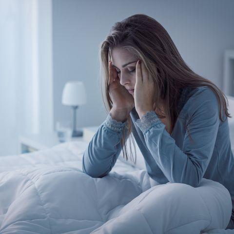 depressed woman awake in the night