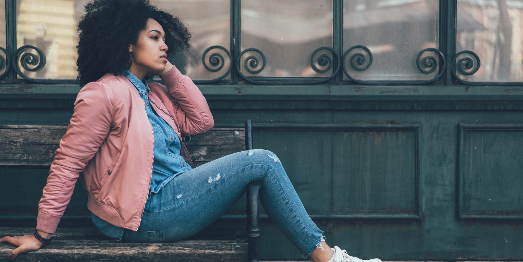 Depressed woman sitting at bench