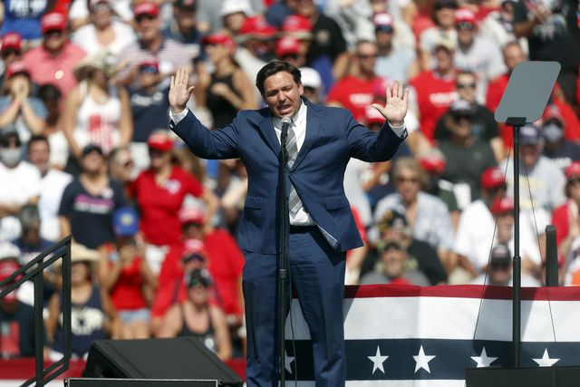 tampa, fl   october 29 florida governor ron desantis speaks to supporters of president donald trump before he arrives to give a campaign speech just four days before election day outside of raymond james stadium on october 29, 2020 in tampa, florida with less than a week until election day, trump and his opponent, democratic presidential nominee joe biden, are campaigning across the country photo by octavio jonesgetty images