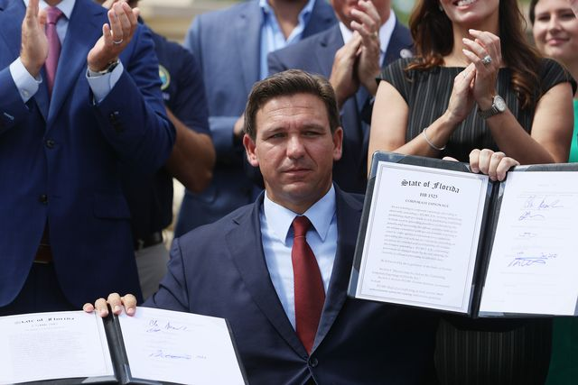 miami, florida   june 07 florida gov ron desantis holds up two bills he signed at the florida national guard robert a ballard armory on june 07, 2021 in miami, florida the governor signed the bills to combat foreign influence and corporate espionage in florida from governments like china photo by joe raedlegetty images
