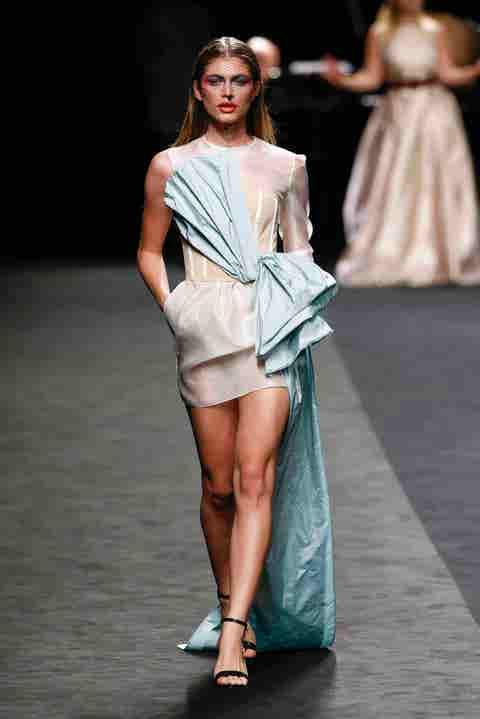 Fashion model, Fashion, Fashion show, Runway, Clothing, White, Shoulder, Fashion design, Beauty, Footwear,