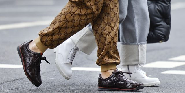 dusseldorf, germany   march 23 white boots by common projects as a detail of influencer gitta banko and dark brown sneaker by gucci as a detail of stylist bert sterck during a street style shooting on march 23, 2021 in dusseldorf, germany photo by streetstyleshootersgetty images