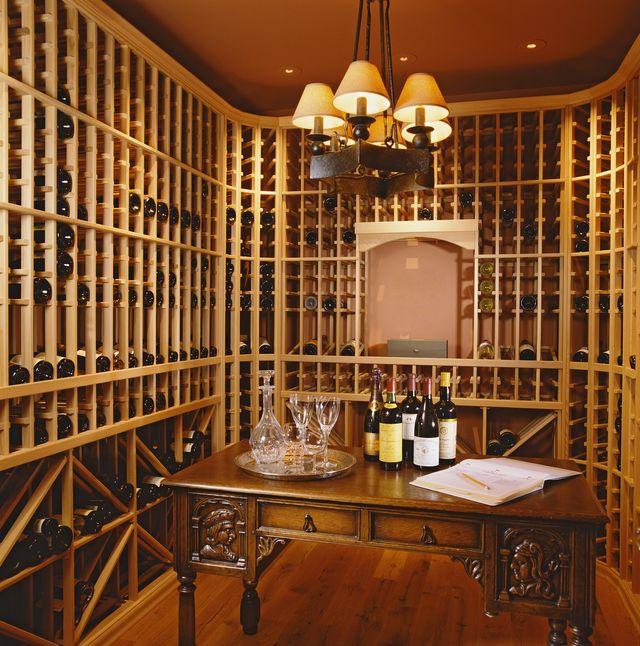 desk and chandelier in wine cellar