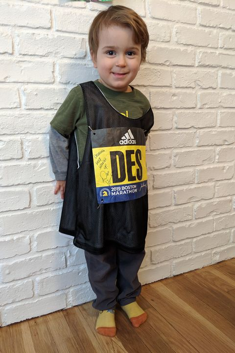 Clothing, Standing, Yellow, Child, Outerwear, T-shirt, Toddler, Footwear, Sleeve, Jacket,