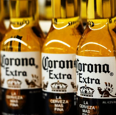 Detail of lined up Corona beer bottles seen on the store...