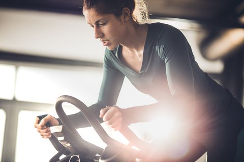 Determined female athlete on a exercising class in a health club.