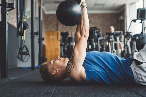 Determined man working out in the gym