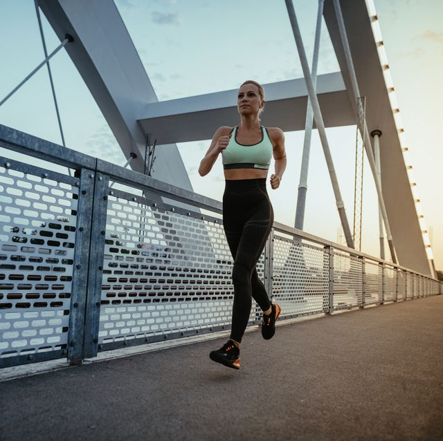 determined mature woman jogging in the evening