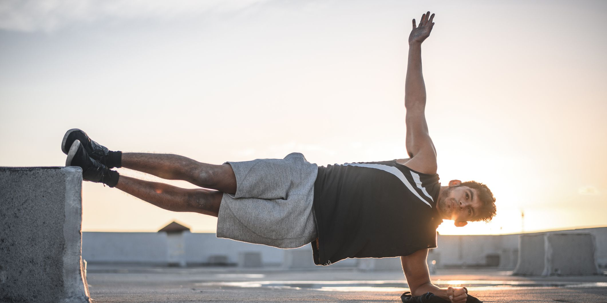 Determined young man exercising in plank position