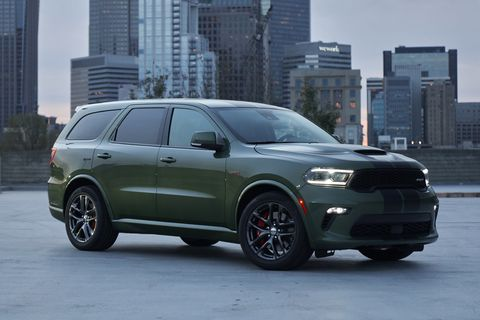 2021 dodge durango srt 392 equipped with the 392 cubic inch hemi v 8 delivering 475 horsepower and 470 lb ft of torque, the durango srt 392 features new aggressive exterior styling and a new interior with a driver centric cockpit, shown here in f8 green with dual low gloss gunmetal stripes