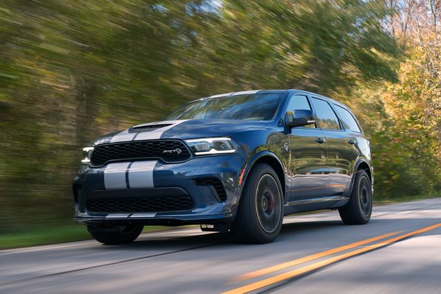 2021 dodge durango srt hellcat the most powerful suv ever features a new aggressive exterior, a new interior with a driver centric cockpit and delivers 710 horsepower, shown here in reactor blue with dual silver stripes