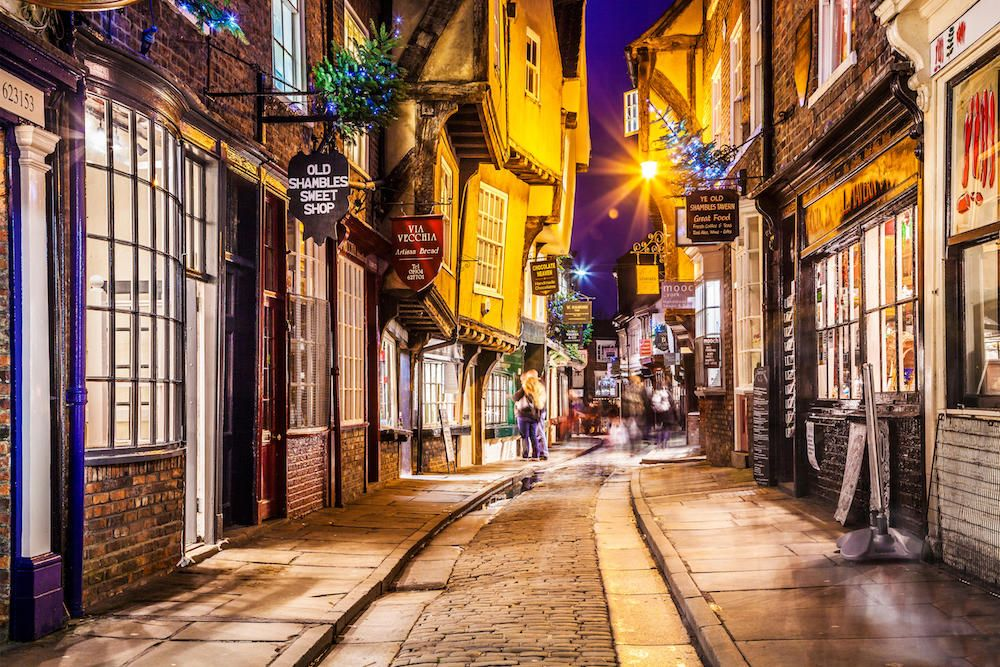 Christmas in The Shambles, the historic, medieval street in the old city centre of York at twilight.