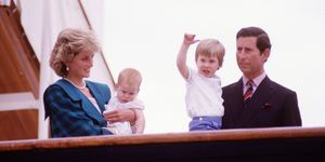 Diana Princess of Wales and Charles Prince of Wales hold Prince Harry and Prince William on the deck of the Royal Yacht Britannia