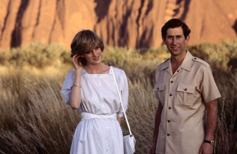 diana princess of wales and prince charles pose in front of ayer's rock