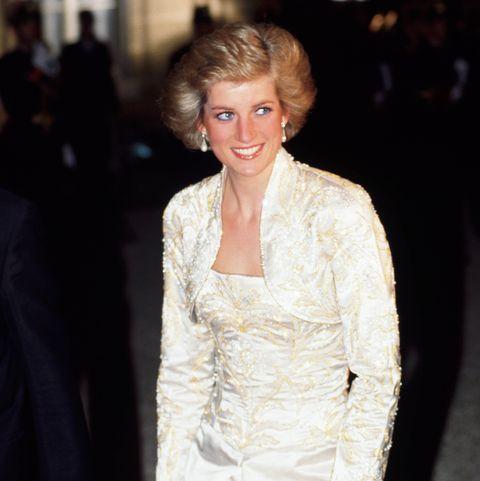 Diana, Princess of Wales wears a white beaded dress and bole