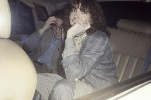Finger, Comfort, Sitting, Car seat, Vehicle door, Head restraint, Thumb, Lap, Beard, Car seat cover,