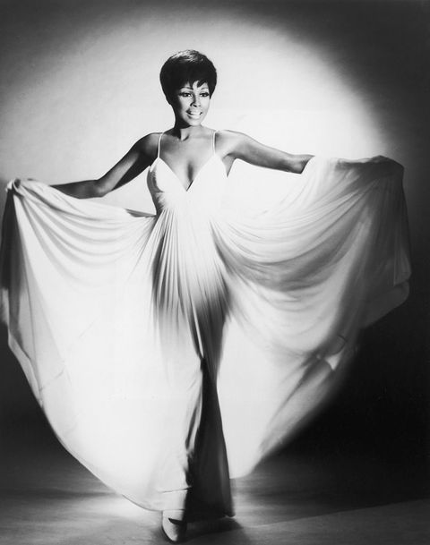 circa 1960  a full length studio portrait of american actor diahann carroll, fanning her long white dress with her arms  photo by hulton archivegetty images