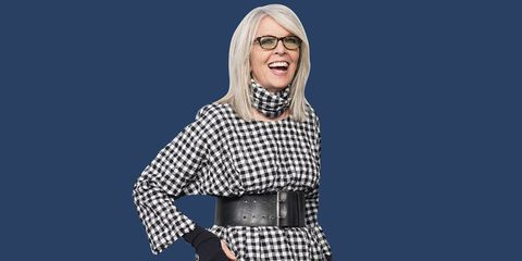 diane keaton wearing gingham against a blue background