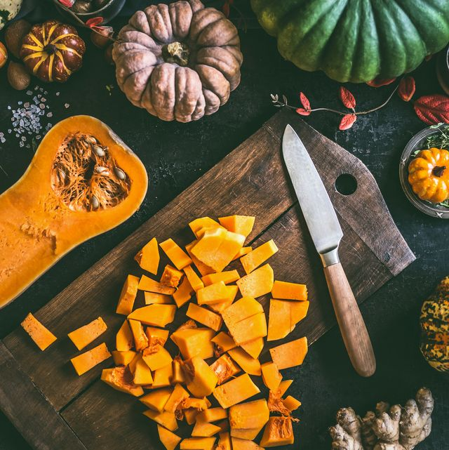 diced pumpkin on cutting board with knife