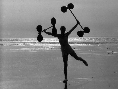Human leg, Standing, Monochrome, Playing sports, Black-and-white, Silhouette, Monochrome photography, Jogging, Beach, Racket,
