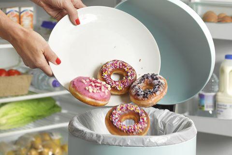 Dieter throwing away donuts