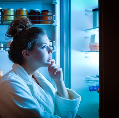 dieting young woman late night making choices on what to eat