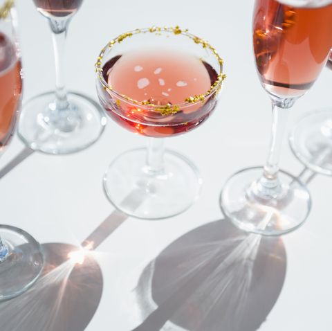 Different wine glasses on white