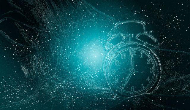 digital composite image of illuminated alarm clock against black background