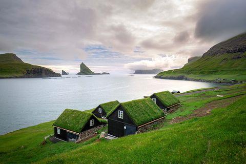 houses near the small village of Bøur, with Drangarnir and Tindhólmur on background. Faroe Islands