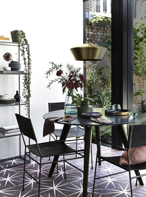 dark, black round dinning table on a plum purple patterned floor brass pendant light above the tablefloor talkstatement tiles are a great way to bring in a hit of unexpected colour into your scheme slimline furnitureand accents of brass ensure the overall effect is sleek and smart aveiro table, £449, made caprichairs, from £160 each, french connection dining plates, £2295 each tumblers, £995 each sideplates, £1795 each all urban nature culture glass vase, £20, graham  green magni green vase, £20, made sakura napkins, £12 each, larusi cutlery set, £145, cox  cox gold tray, £5150, broste copenhagen wolfie shelves, £595, loaf fluted plant pot, £1499, hm home geometric bud vase, £45 for three, cox  cox bjork handblown vase in purple, £2770 bowls, from £9 all broste copenhagen islingtoncushion in blush, £55, heal's brass pendant, £80, houseof lily pad tiles, £12210sq m, ca'pietra