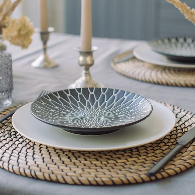 dinnerware set on table set with flowers and candlesticks