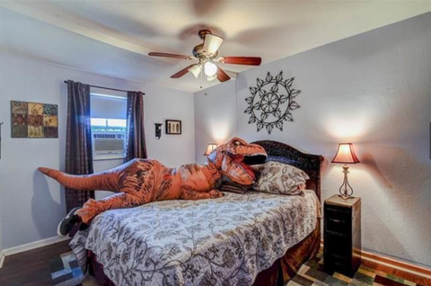 Dinosaur in Bedroom - Dinosaur Home Listing