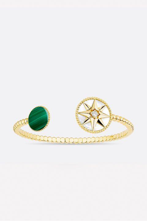 Earrings, Circle, Natural material, Symbol, Body jewelry, Gemstone,