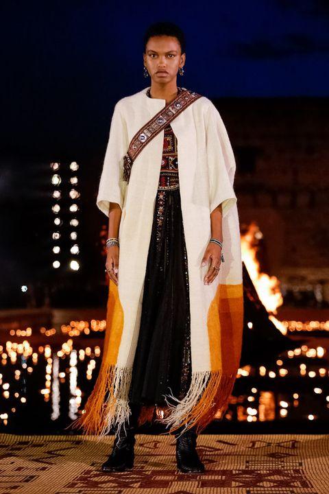 Clothing, Formal wear, Fashion, Fashion design, Sari, Tradition, Outerwear, Event, Performance, Night,