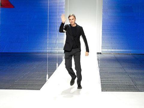 Standing, Flag, Denim, Blazer, Street fashion, Knee, Electric blue, Flash photography, Fashion model, Shadow,