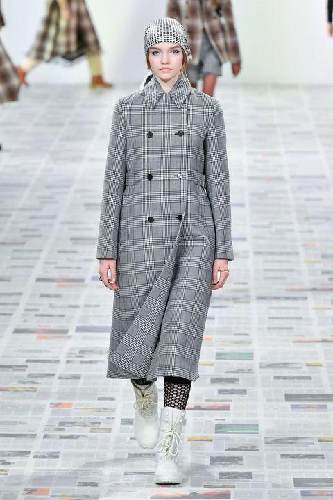 Fashion, Fashion show, Runway, Clothing, Fashion model, Overcoat, Outerwear, Coat, Street fashion, Human,