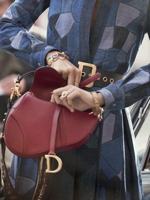 Pink, Jeans, Shoulder, Joint, Footwear, Bag, Hand, Denim, Fashion accessory, Street fashion,