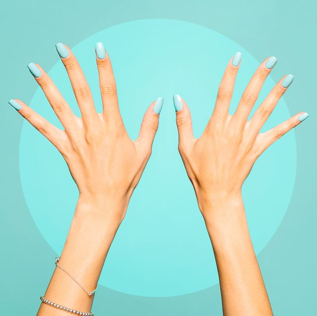 blue nail polish on manicured hands