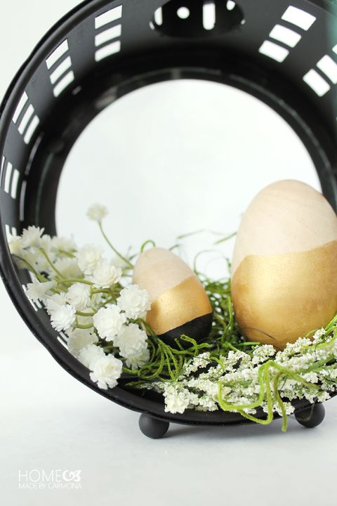dipped wooden easter eggs in a hanging lantern