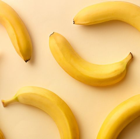 Directly Above Shot Of Bananas Over Beige Background