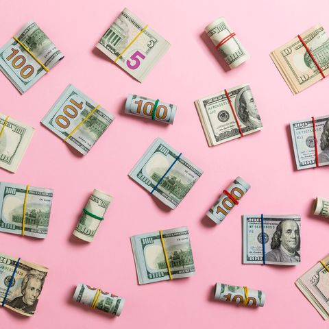 directly above shot of banknotes over pink background