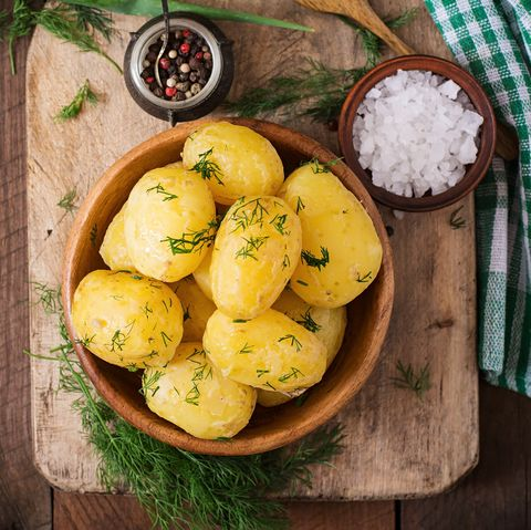 Directly Above Shot Of Boiled Potato In Bowl On Cutting Board