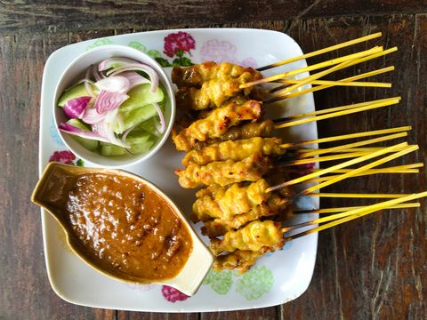 Chicken Satay And Salad With Sauce In Plate On Table