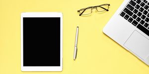 Directly Above Shot Of Digital Tablet With Pen And Laptop On Yellow Background