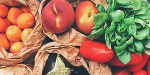 Directly Above Shot Of Fruits And Vegetables In Paper Bags