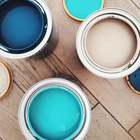 Directly Above Shot Of Paint Cans On Table