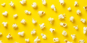 Popcorn On Yellow Background