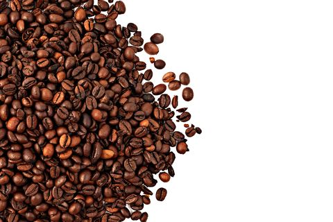 Directly Above Shot Of Roasted Coffee Beans Over White Background