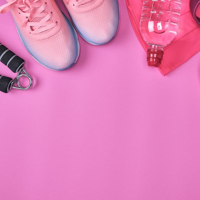 Directly Above Shot Of Sports Equipment On Pink Background
