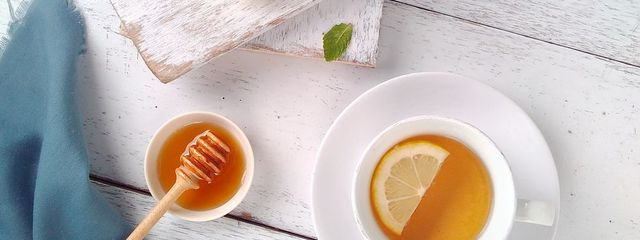 Directly Above Shot Of Tea By Lemons On Table